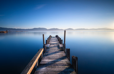 Wooden pier or jetty at sunrise. Versilia Tuscany, Italy