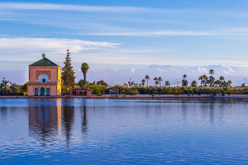 Menara Pavilion reflected on pond and Atlas mountains - Marrakesh, Morocco