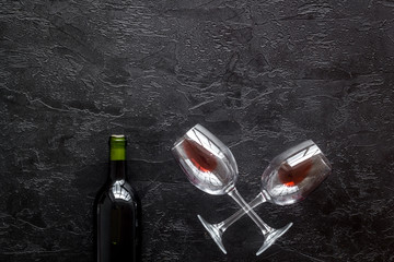 Fototapete - Wine bottle and glasses on black background from above copy space