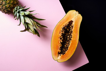 Still life composition with sliced papaya and pineapple