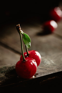 Two sour cherries with water drop