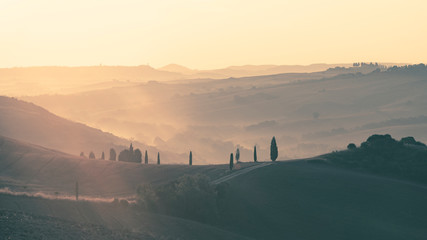 Foto op Plexiglas Zalm Beautiful sunrise over the Tuscany hills and fields. Travel destination Tuscany
