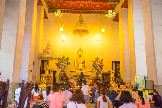 Background of one of the major tourist attractions in Bangkok(Wat Suthat Thepwararam)with beautiful churches and pagodas,popular people come to make merit and take pictures during holidays in Thailand