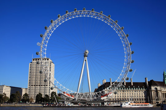 London, UK, Oct 15, 2011: The London Eye in London's Westminster  viewed from the north bank of the River Thames stock photo