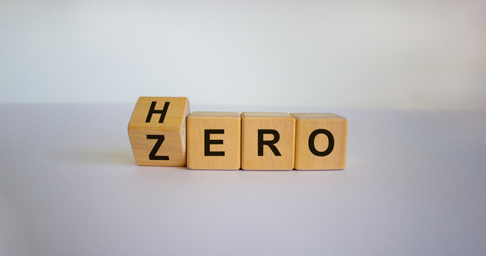 From zero to hero concept. Hand turns a cube and changes the word 'zero' to 'hero'. Beautiful white background. Concept. Copy space.