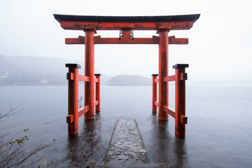 Red torii gate of the Hakone shrine near lake Ashi, Japan
