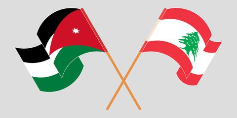 Crossed and waving flags of Lebanon and Jordan