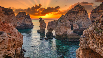 Sunrise over stunning cliffs and arches in Ponta da Piedade, Lagos, Algarve, Portugal