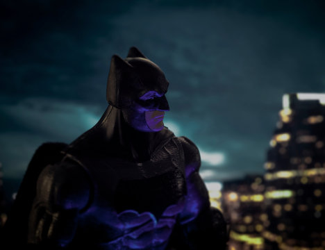 NEW YORK USA, APRIL 20 2020: Batman watches over Gotham City - DC Comics - action figure