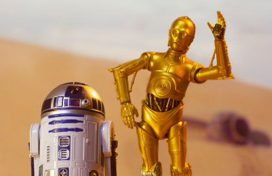 NEW YORK USA, MAY 13 2020: Recreation of a scene from Star Wars A New Hope depicting droids C-3PO and R2D2 on the desert planet of Tatooine with escape pod - Hasbro action Figure