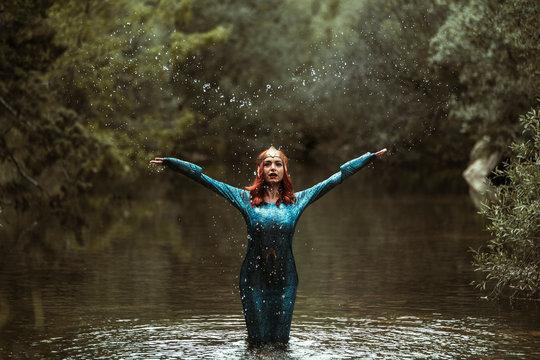 Redhead woman posing with superhero costume