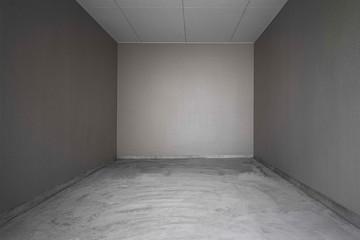 Perspective of Empty dark basement concrete room.