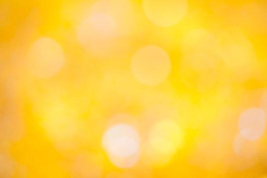 Defocused yellow glitter backgound