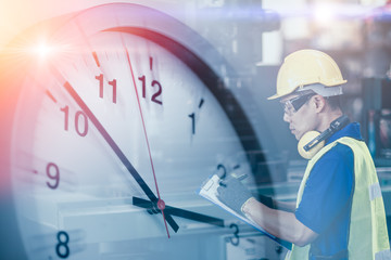 Engineer worker looking service check list in factory overlay with time clock for working hours concept.