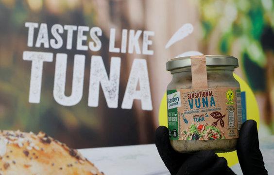 Staff holds a jar of Sensationnal Vuna at Nestle research center in Lausanne