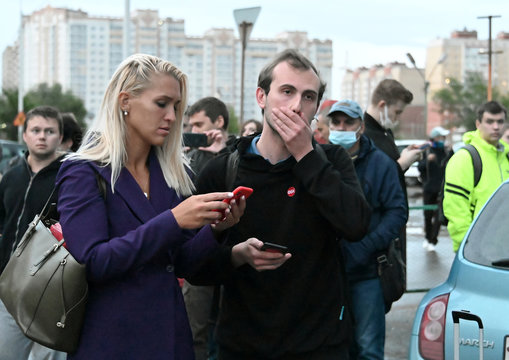 Anastasia Vasilyeva, a personal physician of Alexei Navalny, and Ilya Pahomov from Anti-Corruption Foundation leave a hospital where Navalny was admitted, in Omsk