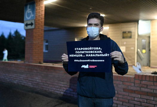 A man stands in a one-person picket outside a hospital where Russian opposition leader Alexei Navalny was admitted, in Omsk