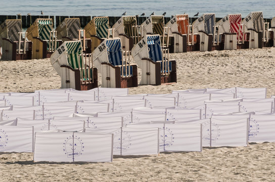 KOLOBRZEG, WEST POMERANIAN / POLAND - 2020: Beach baskets and windbreaks on the sea coast