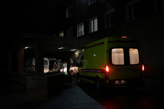 Ambulances and medical workers are seen outside a hospital where Russian opposition leader Navalny was admitted, in Omsk