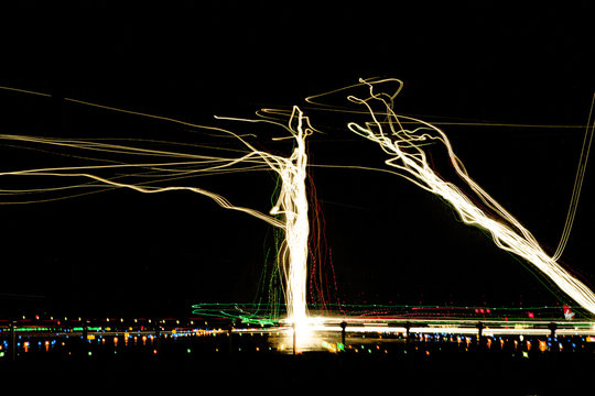 28R Approach -Composite photograph of light trails of multiple aircraft landing at night at San Francisco International Airport. San Francisco, CA USA