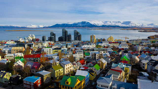 Aerial view of colorful buildings in Reykjavik Iceland with mountains and clouds in the background