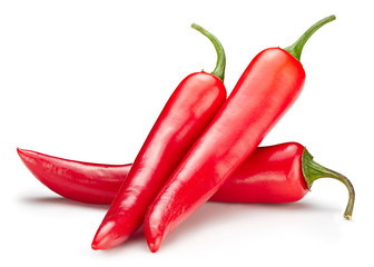 Chili macro studio photo. Ripe red hot chili peppers vegetable isolated on white background. Hot peppers chili composition with clipping path.