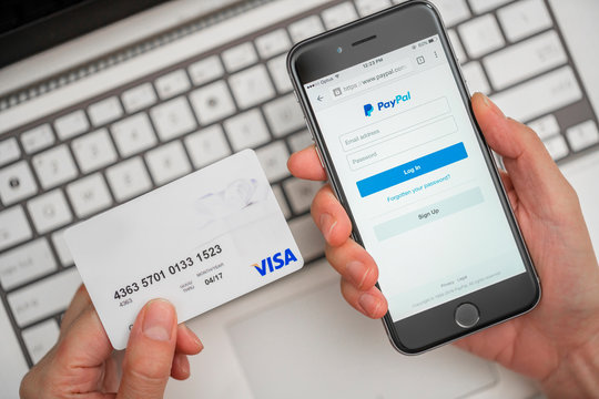 Melbourne, Australia - May 10, 2016: Using PayPal and credit card for online shopping. PayPal is a worldwide online payment system and one of the most popular ways of making payment on the Internet.