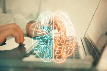 Man typing on keyboard background with brain hologram. Concept of big Data. Papier Peint