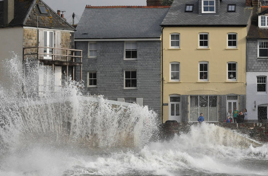 Large waves hit the sea wall with the arrival of Storm Ellen, in Kingsand