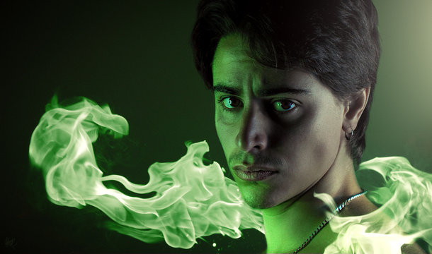 Portrait of a man surrounded by green fire