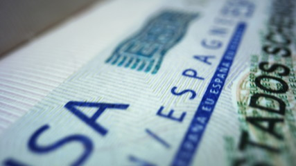 Spanish visa in foreign passport. Schengen visa in document. Travelling concept