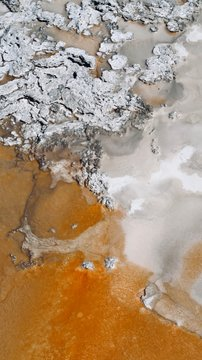 Abstract Orange and White Natural Spring with Gray Rocks