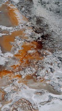 Abstract Orange and White Natural Spring with Dark Gray Rocks