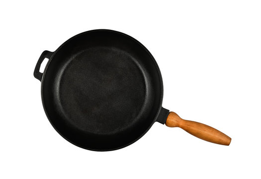Cast iron frying pan with wooden handle isolated