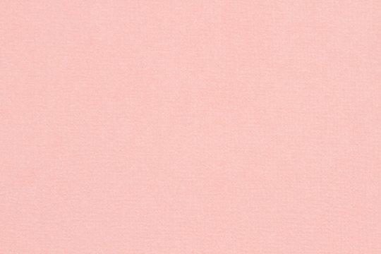 Light pink textured cardstock paper closeup background
