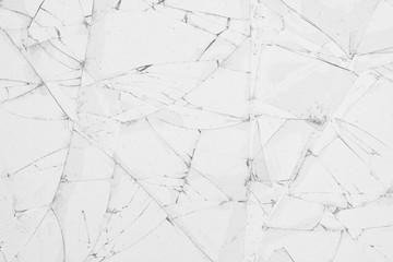 White cracked glass texture background. Texture broken glass window with cracks. Broken screen.