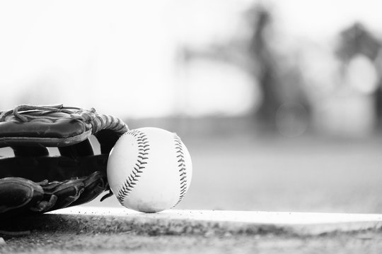 baseball and glove on ball field