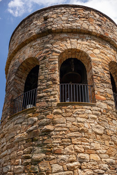 Low angle vertical shot of the stone Chimes tower in the Longwood Gardens, USA