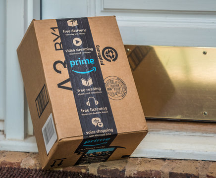 ATLANTA, GEORGIA - AUGUST 19, 2019 :  Amazon prime box delivered to residential doorstep. Amazon offers free package delivery to it's prime members.