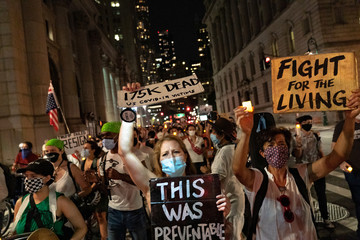 Demonstrators against U.S. President Donald Trump protest for him to resign, during a march to honor people who have died during the coronavirus disease (COVID-19) outbreak, in Manhattan
