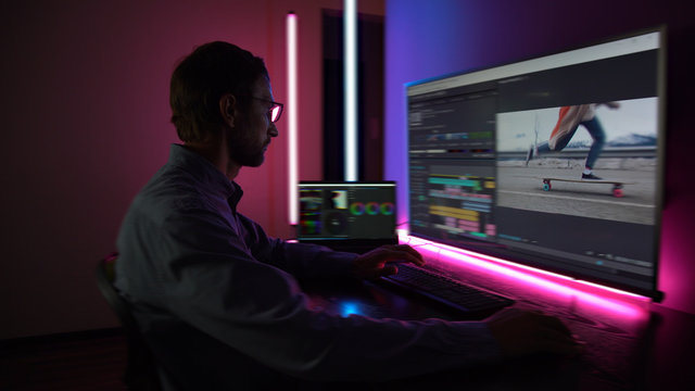 The man makes video editing. Video production. Color Correction. Sound editing. Film making. The work of a freelancer. Equipment filmmaking. Create videos. Program for video editing.