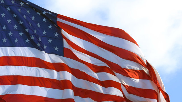 American flag waving proudly in the wind, close up