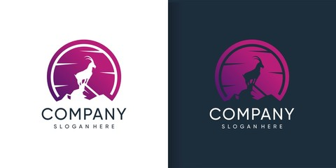 Goat logo standing in the mountain with silhoutte concept Premium Vector