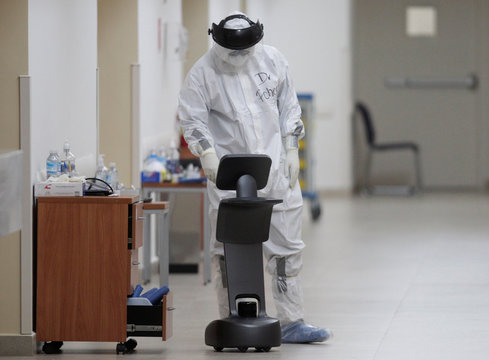 A healthcare worker uses a robot to carry out consultations with patients suffering from the coronavirus disease COVID-19, at NOVA hospital in Monterrey