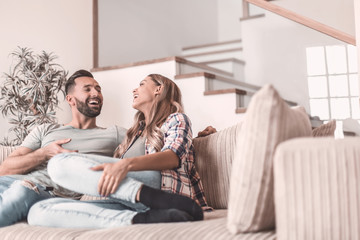 loving couple relaxing on the couch on a free evening