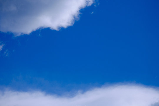 Low angle shot of a cloudy blue sky - perfect for background