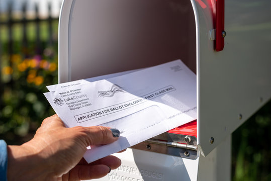 Barrington, IL/USA - 08/22/2020:  Homeowner receives applications for mail-in ballot for 2020 presidential election in home mailbox via US Postal Service