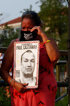 People rally in Denver calling for an end to police violence