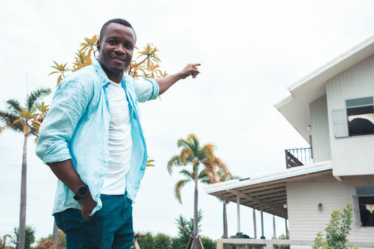 An American black man is happy to buy a new house by saving money from his work all his life. Family building concept and start a new life. Property and Business