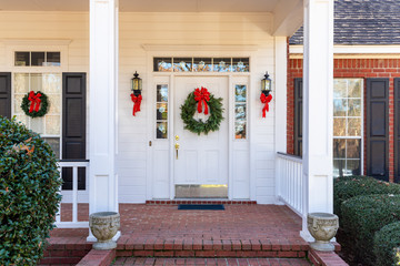 Residential home front door decorated for Christmas